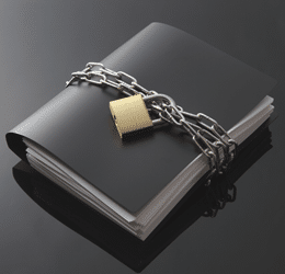 Counselling and the Law - a black file book bound in chains and a padlock to communicate confidentiality
