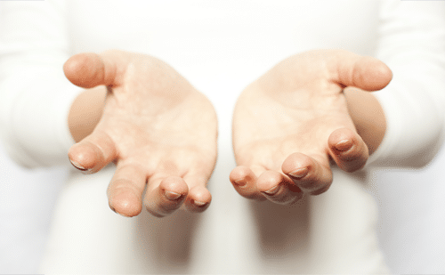 Unconditional Positive Regard in Counselling: An image of two open hands communicating acceptance