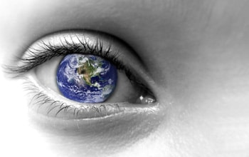 Humanism approach to counselling - a closeup of an eye with the world as the iris