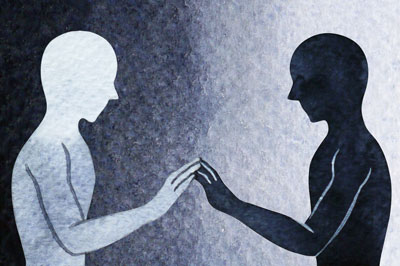 Two persons with their hands touching - The image means to communicate relational depth in counselling, which is used to explain the deep connection between counsellor and client that can be present within a therapeutic relationship.