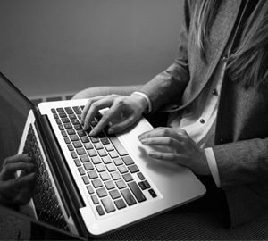 Counsellor with Online Therapy Competencies using laptop for counselling