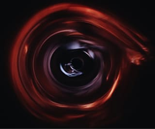 Black hole effect in online counselling - Photo of a circular swirl of red against a dark background